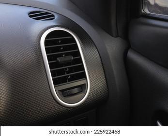 Closeup of a car dashboard air vent