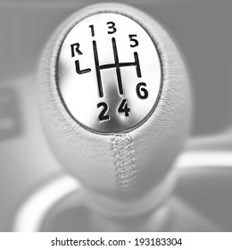 Close-up of a car gear lever.
