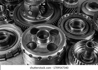 Close-up of a car gearbox. Metallic shiny gears for planetary gearshift. Industrial metal gears for Background