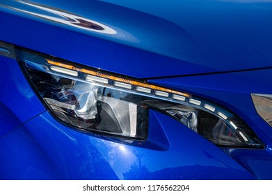 Closeup of car headlight. Modern LED headlights provide a wide range of vision and can save drivers money over the lifetime of a car, and are increasingly becoming a standard feature in new car models