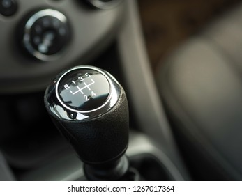 Close-up car interior manual gear lever. signs and figures on the gear lever