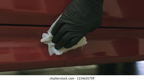closeup of car paint degreasing with alcohol before polishing