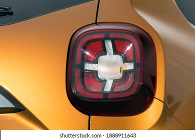 Close-up  car rear tail-lamp with a tail light stop signal.
