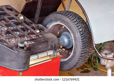 Closeup of car wheel balancing in tire service.