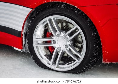 Close-up car wheel with tire flat and air leak from accident. on the winter  road