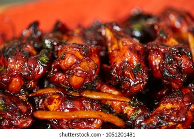 Closeup of caramelized chicken wings, a delicious thai recipe