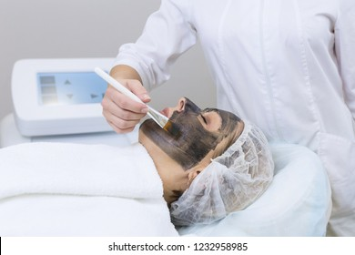 Close-up of carbon peeling procedure for middle-aged woman face. Laser pulses clean skin. Process of photothermolysis, warming, laser carbon peeling. Facial skin rejuvenation, cosmetology treatment