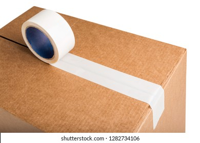 Closeup of cardboard box with white adhesive tape isolated on white background