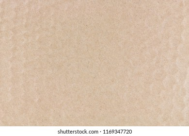Close-up of a cardboard surface.