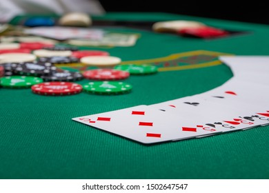 Close-up cards for playing poker on a gaming table in a casino against a background of chips. Background for a gaming business