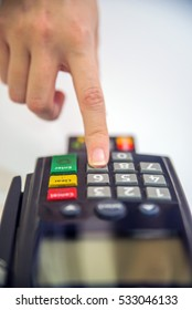 Close-up of cards servicing with POS-terminal. Color image of a POS and credit cards.