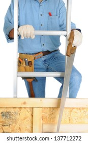 Closeup of  a carpenter climbing a ladder isolated over white. The man wearing a work shirt, jeans, gloves and a tool belt is partially hidden behind a wood framed wall. Vertical Format.