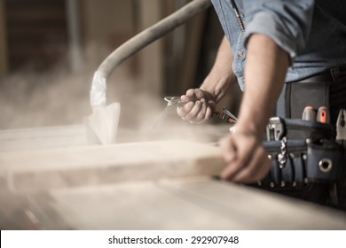 Close-up of carpenter's hands working with wood