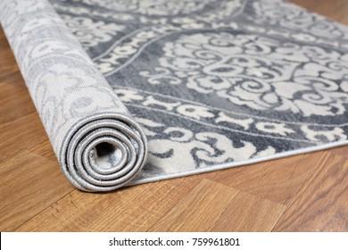 Close-up carpet on laminate wood floor in living room, interior decoration