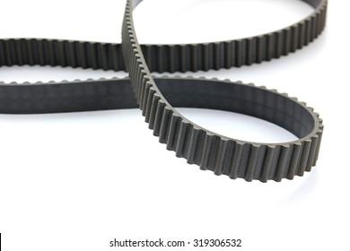 Close-up of car's engine belt on white background.