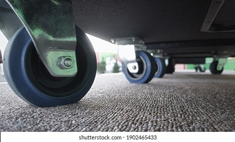 Close-up of cart wheels or trolley wheels, transporting heavy loads. Bottom view.