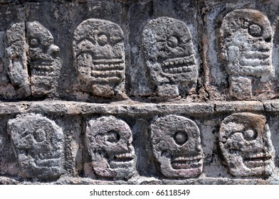Closeup of carved skulls in a Mayan temple in Chichen Itza, in Mexico