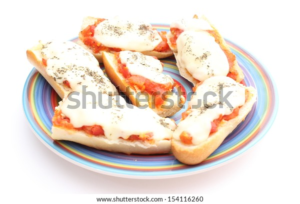 Closeup of casserole with mozzarella, tomato and basil on colored plate. Isolated on white background