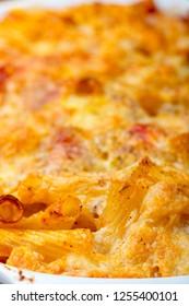 closeup of a casserole with rigatoni gratin