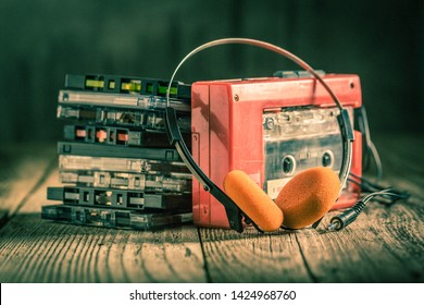 Closeup of cassette tape, red walkman and headphones
