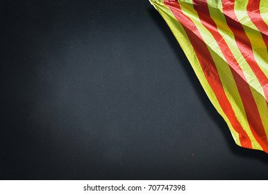 Close-up of catalan senyera flag on a blackboard