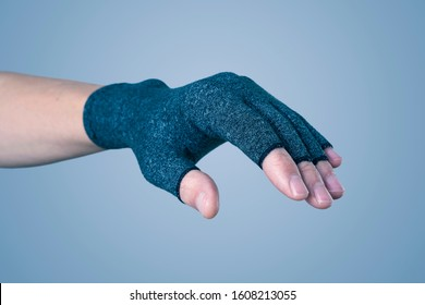 closeup of a caucasian man wearing a compression glove