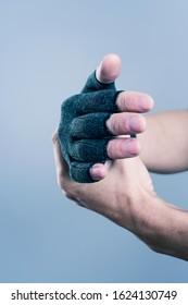 closeup of a caucasian man wearing a dark gray compression glove