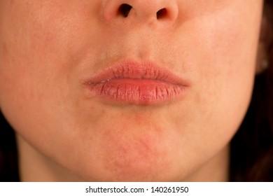 Closeup of caucasian woman kissing, front view