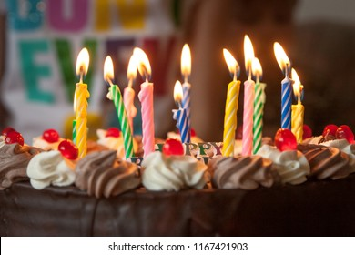Close-up of celebrating cake with burning candles