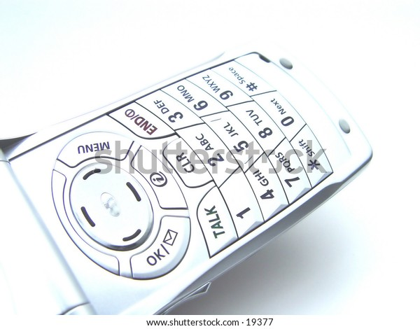 Closeup of a cellular phone keypad, isolated on white background
