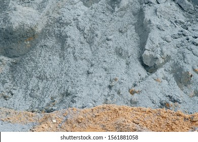 The close-up of a cement pile on a construction site.