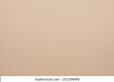 Closeup of cement wall painted in warm light brown or beige tone for vintage decoration and simple background. Cool banner on website, page, ad, presentation