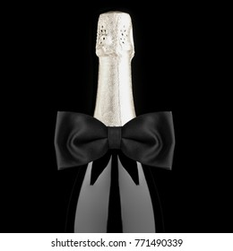 Closeup of a Champagne Bottle with Black Bow Tie isolated on black background square format desaturated.