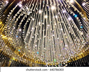 Closeup of chandelier crystal light on a ceiling