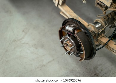 Closeup Changing Wheels On A Car Garage With Soft Focus And Over Light In  The