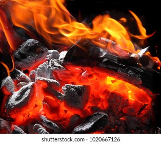 Closeup of charcoal burning with fire flames.Burning charcoal texture