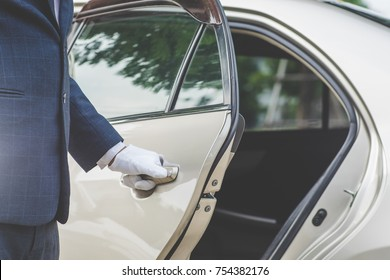 Closeup of Chauffeur opening car door with glove