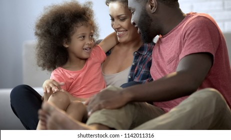 Close-up of cheerful family enjoying time together and having fun at home