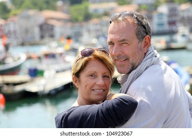 Closeup of cheerful senior couple in vacation