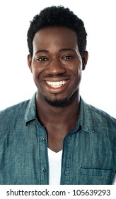 Closeup of cheerful young african guy isolated against white