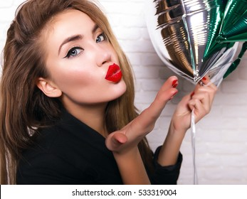close-up cheerful young lady in perfect mood having fun,and sending kiss on camera, isolate on white background. Wearing trendy jacket,red nails and matte lips,funny  and Positive concept.wow girl