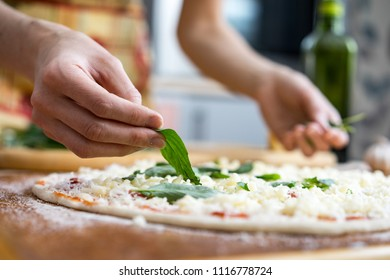 Close-up of chef cooking food kitchen restaurant cutting cook hands hotel man male knife preparation fresh preparing concept