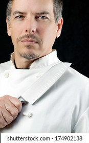 Close-up of a chef displaying his knife, portrait.