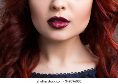 closeup cherry lips. girl with red hair. the lower part of the face. Fashion Girl Portrait.