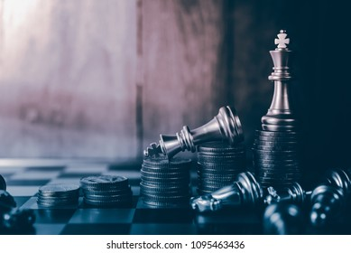 Closeup of chess characters on board games. to represent decision making in term of business strategy to find out the best solution to meet target objective and goal.