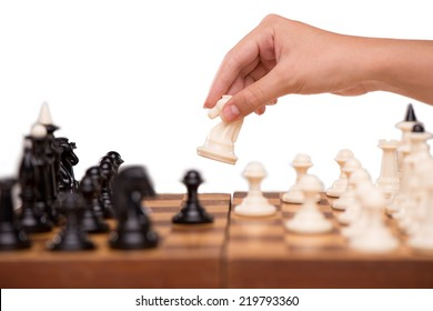 Close-up of chess and female hand