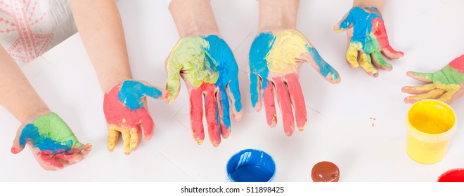 Close-up of children with color painted hands
