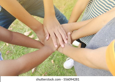 Close-up of children putting their hands together.  Team work or Child experience concept. Selective focus.