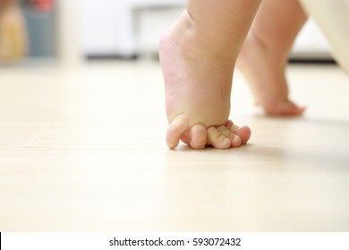 Close-up of child's feet on the floor
