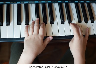 Close-up of a child's hand playing the piano . Favorite classical music. musical instruments for teaching music at home. The concept of a musical instrument. Self-education